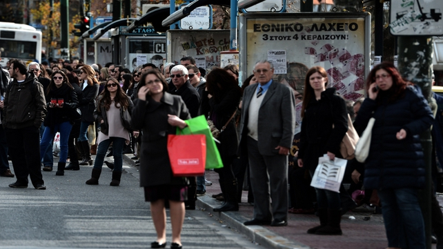 People wait for a bus in the Greek capital as subway workers strike