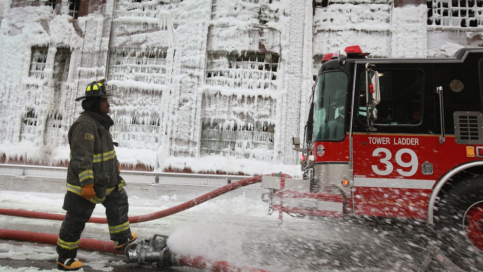 More than 200 firefighters battled a five-alarm fire
