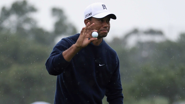 Tiger Woods hit four birdies and an eagle three in his opening 11 holes