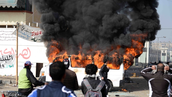A minibus was set on fire outside Port Said prison as crowds reacted to the verdict