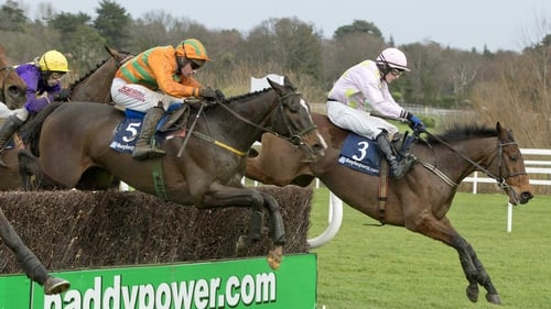 Texas Jack (orange and green) is brought with a well-timed challenge by Paul Carberry