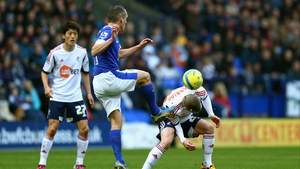 Leon Osman clears for Everton with Jay Spearing in the danger area