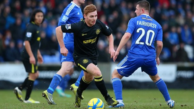 Wigan's Fraser Fyvie breaks away from Waide Fairhurst of Macclesfield