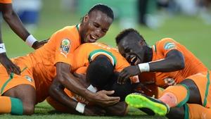 Yaya Toure (m) celebrates scoring a goal with Didier Drogba and Max Gradel