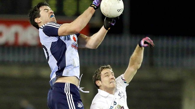 Dublin's Michael Daragh MacAuley with Gary White of Kildare