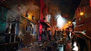 Firefighters try to put out the fire at a nightclub in Santa Maria