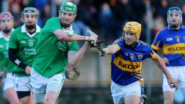 Tipperary's Joey McLaughin and Seamus Hickey of Limerick