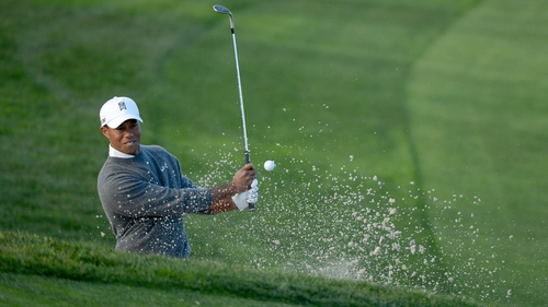 Tiger Woods leads by four shots at the Farmers Insurance Open