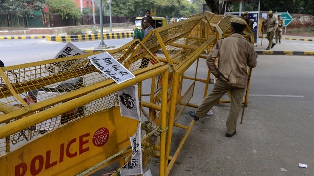 Anti-rape posters draped on a police barricade in New Delhi