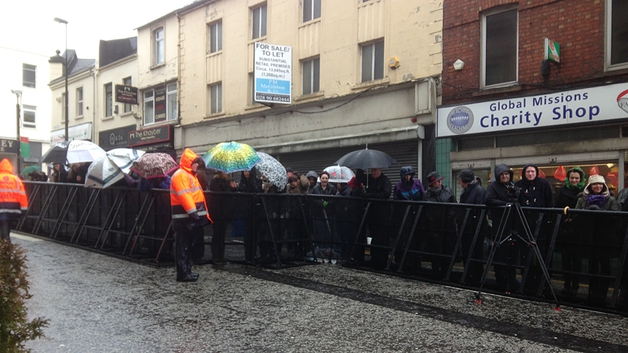 Locals braved the weather to welcome Neeson home