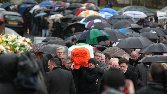 The coffin of Dolours Price is draped with the Irish flag as it is carried to St Agnes' Church in west Belfast