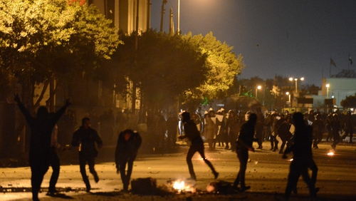 Egyptian protesters clash with riot police near Cairo's Tahrir Square