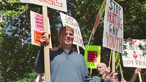 """John Schuppan and other demonstrators from """"Scouting for All'' protest outside the National Capital Area Council for the Boy Scouts of America in 2000"""