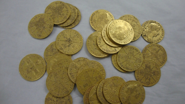 Gold guineas dating back to Charles II were found
