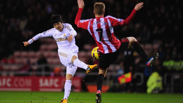 Swansea's Ki Sung-yeung unleashes a volley at the Stadium of Light