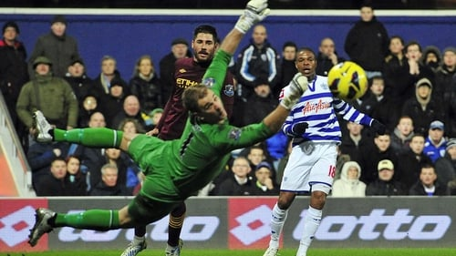 QPR's Loic Remy watches his shot go wide of Joe Hart and the Manchester City goal