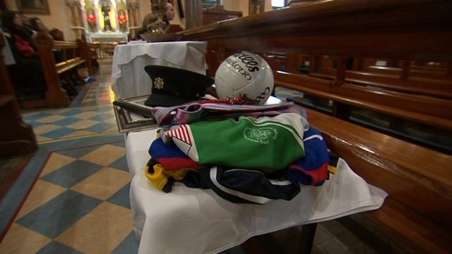 The gifts include football jerseys and a ball, symbolising Det Garda Donohoe's passion for GAA
