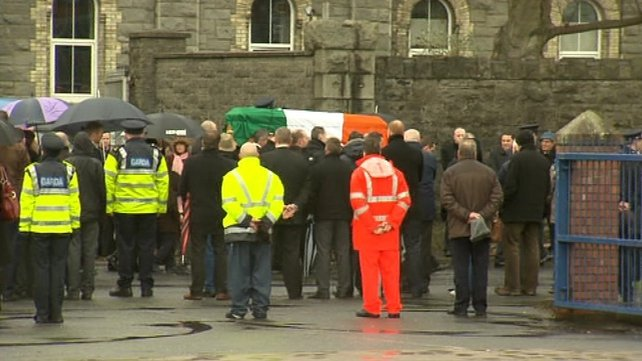 Det Garda Adrian Donohoe's coffin was draped in a Tricolour as it was carried into the church
