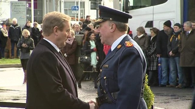 Garda Commissioner Martin Callinan greeted Taoiseach Enda Kenny outside the church