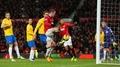 Rooney double enough for below-par United