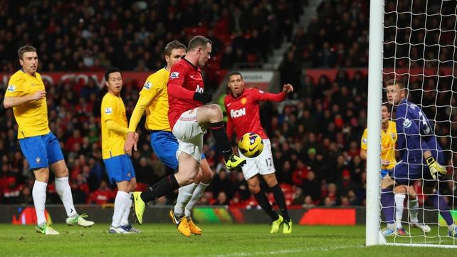 Wayne Rooney taps in United's opener