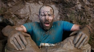 A competitor emerges from an underground tunnel during the Tough Guy Challenge in Telford, England