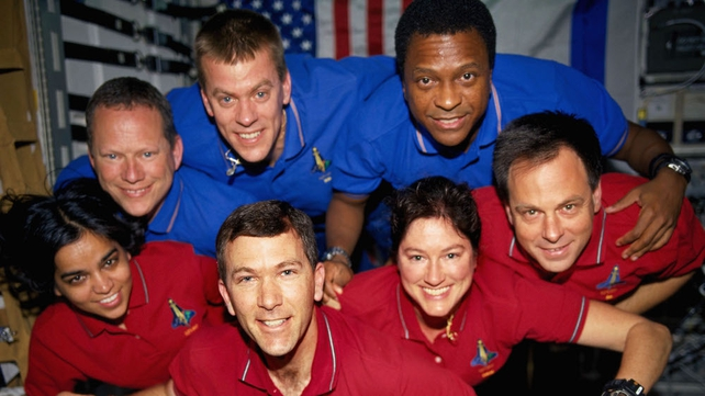 Crewmembers pose for their traditional in-flight crew portrait aboard Columbia taken between 16 January and 1  February 2003 in space