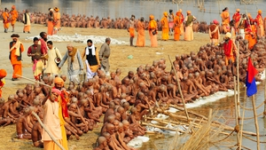 Newly initiated 'Naga Sadhus' perform rituals on the bank of the Ganga River during the Maha Kumbh festival in Allahabad