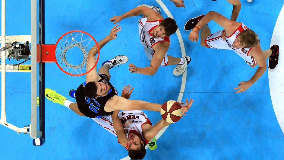 Jeremiah Trueman (Wildcats) and Alex Pledger (Breakers) compete for the ball during the NBL match between the New Zealand Breakers and the Perth Wildcats in Auckland, New Zealand