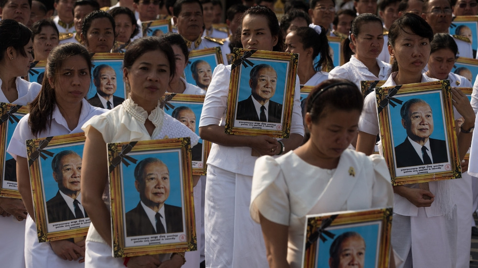 Members of the funeral procession carry portraits of former King Norodom Sihanouk Phnom Penh, Cambodia