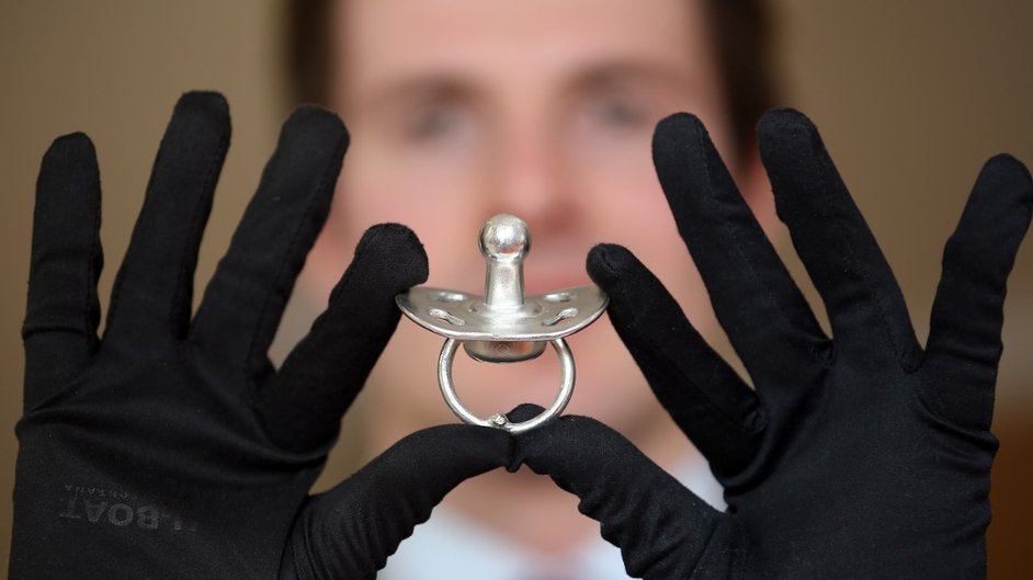 Jeweller Matt Case holds the world's most expensive dummy, valued at £54,000 (€62,093), at bespoke jewellers Russell & Case in Liverpool