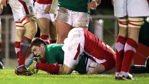 Ireland's Luke McGrath scores the first try of the game in in Colwyn Bay