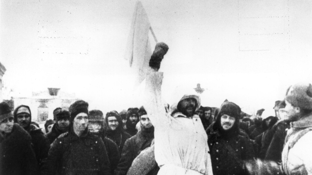 January 1943: German soldiers surrendering to the Russians in Stalingrad, the soldier holding the white flag of surrender is dressed in white so that there could be no doubt of his intentions