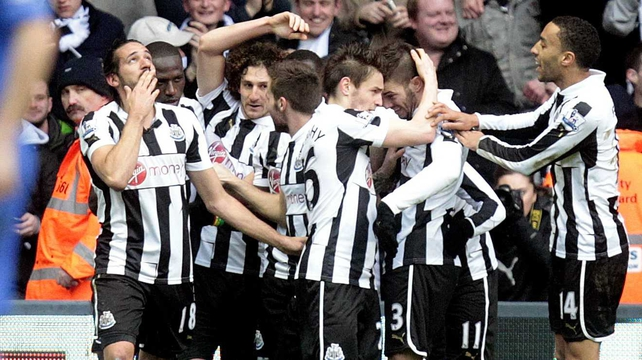 Newcastle United celebrate Jonas Gutierrez's opening goal at St James' Park