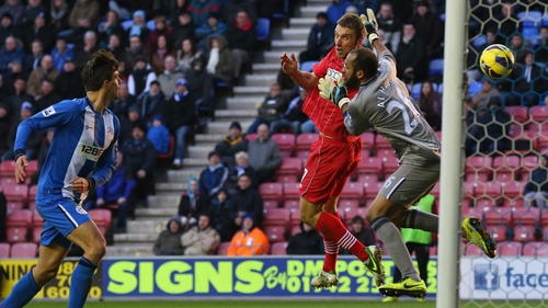 Rickie Lambert gets in ahead of Wigan keeper Ali Al Habsi to score for Southampton at the DW Stadium