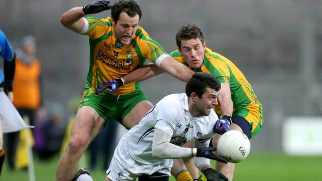 Kildare's Padraig O'Neill under pressure from Michael Murphy and Declan Walsh of Donegal