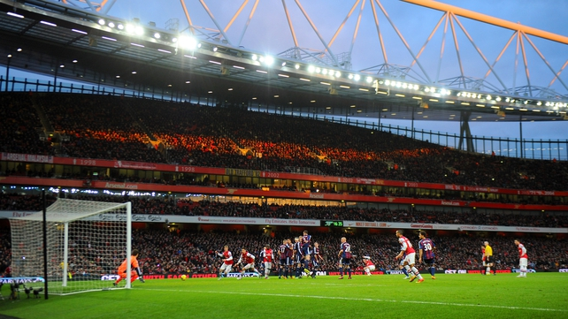Lukas Podolski scores the winner at the Emirates