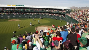 Phil Mickelson putts for victory at the Phoenix Open in Scottsdale, Arizona