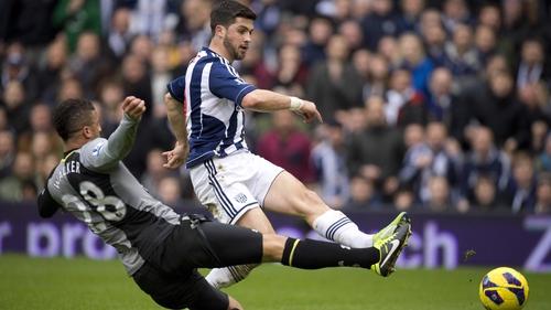 Ireland international Shane Long gets a shot away under pressure from Tottenham Hotspur defender Kyle Walker
