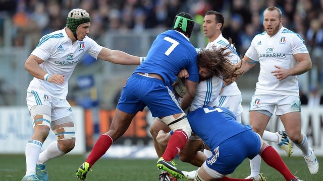 Italy's prop Martin Castrogiovanni (c) vies with France's flanker Fulgence Ouedraogo and France's lock and captain Pascal Pape