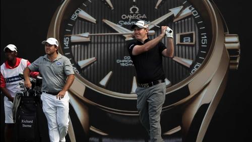Stephen Gallacher watches his tee shot, while Richard Sterne clocks where the ball lands in Dubai
