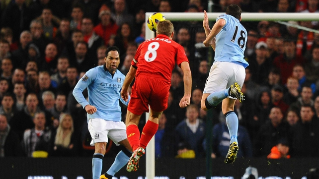 Steven Gerrard watches his shot head for the net against City