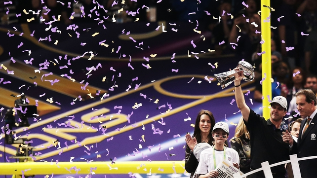 Baltimore head coach John Harbaugh holds the Vince Lombardi trophy aloft