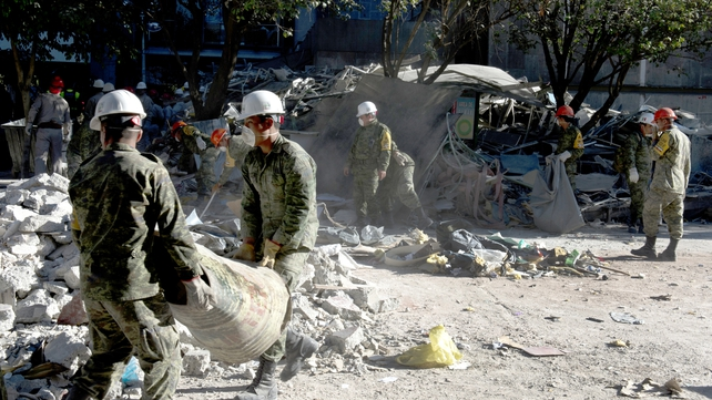 Mexican soldiers remove debris at the building of state-owned Mexican oil giant Pemex