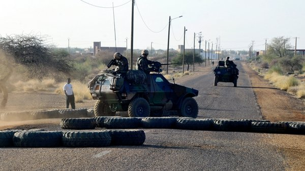 French troops pass a road block on the airport road in Gao earlier this week