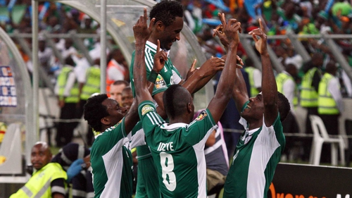 Nigeria celebrate scoring their third goal at the Moses Mabhida Stadium