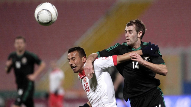Malta's Andrew Cohen vies for possession with Northern Ireland's Niall McGinn
