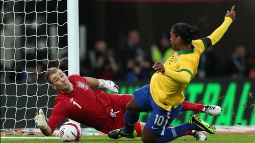 Joe Hart reacted quickly to deny Ronaldinho's follow up to his missed penalty