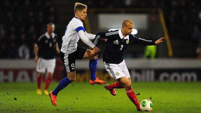 Scotland's Alan Hutton comes under pressure from Tarmo Kink