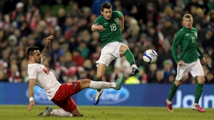 Wes Hoolahan hurdles a tackle during Ireland's 2-0 international friendly against Polan